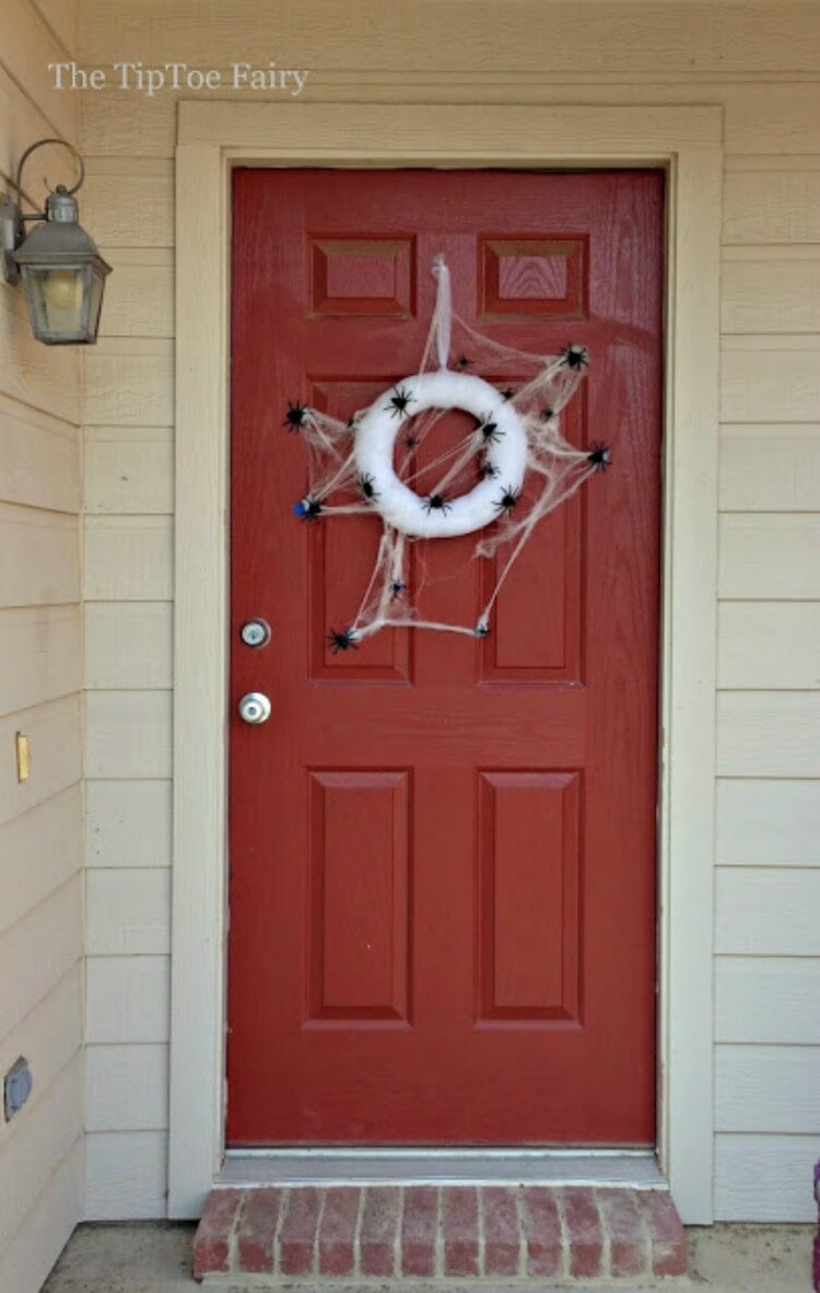 See the Spider Web Wreath on our front door.