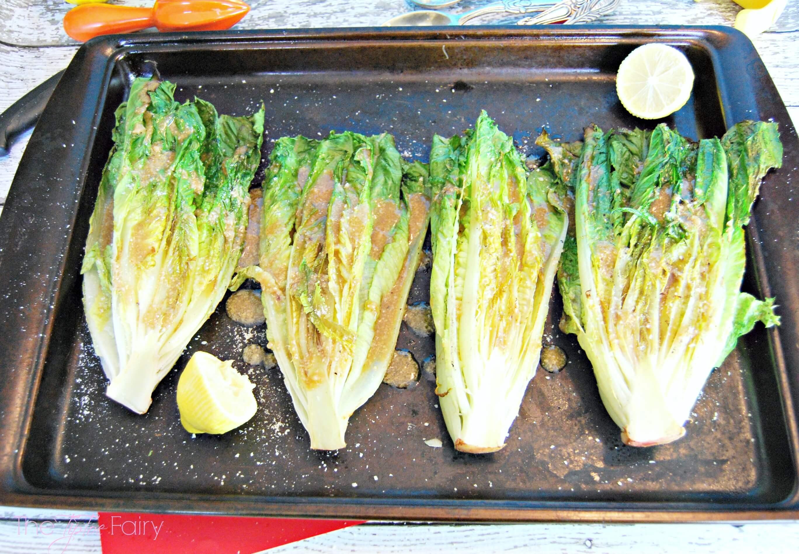 Grilled Romaine lettuce with Caesar vinaigrette dressing.