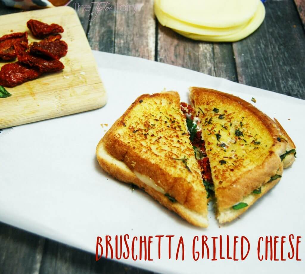Bruschetta Grilled Cheese - an amazing grilled cheese sandwich full of provolone, garlic, basil, and sun dried tomatoes! A delicious comfort food! #ShareYourCheesy #ad