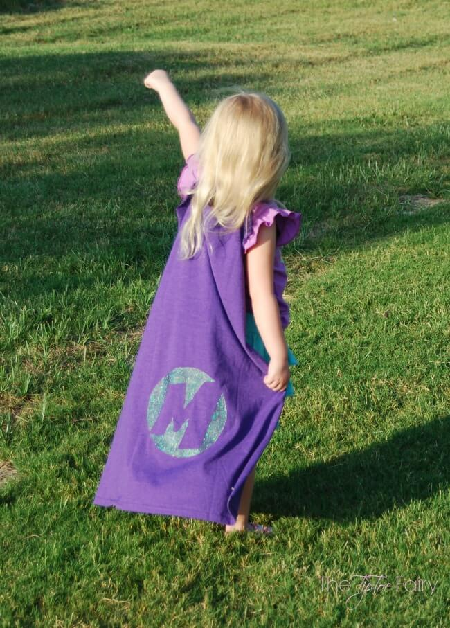 Make an upcycled cape from old t-shirts. Stencil it with a superhero logo with Glad Press'n Seal #ad #pmedia #pressnsealhacks @gladproducts @Walmart | The TipToe Fairy