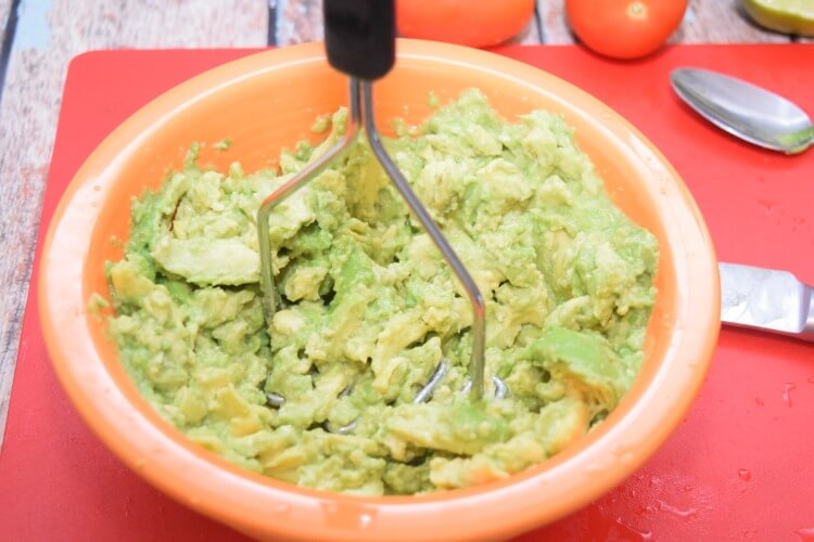 Easy fresh Guacamole chocked full of #LaVaquitaCheese and veggies! #ad #food