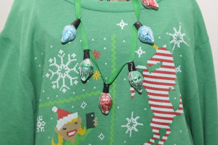 accessorize your ugly sweater wa kisses kissmas sweater chocolates necklace ad