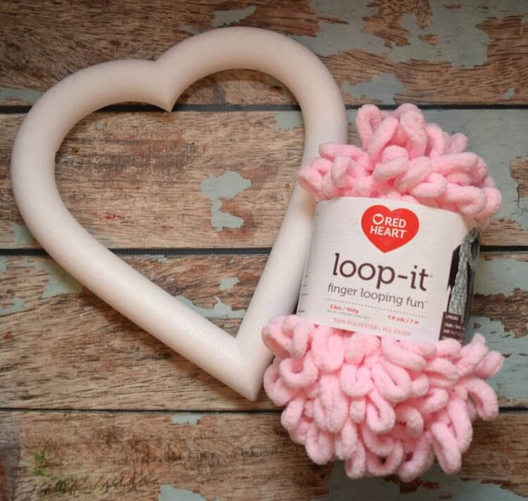 Use finger loop yarn and a styrofoam heart wreath for this Valentine's Day Wreath