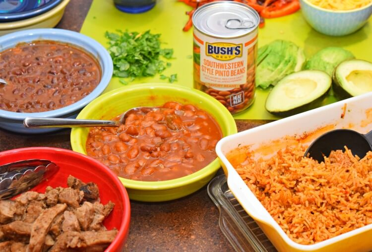Buffet style fixins for Steak Burrito Bowls