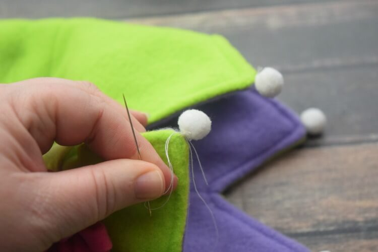 Sew PomPoms to Fleece Crown points