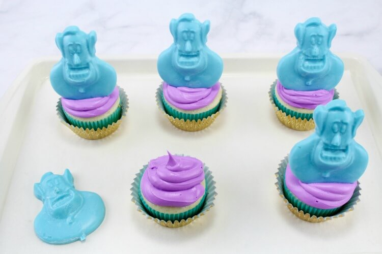 Top the cupcakes with the blue genie chocolates.