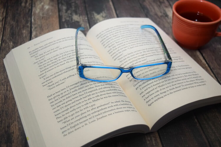 Open book and readying glasses