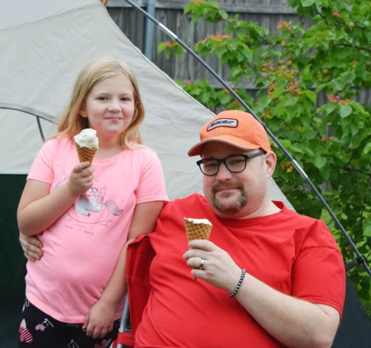 Daddy and daughter enjoying some Do Root Beer Floats make you think of your childhood? Come see how I recreated my favorite childhood memory with my kids and get the recipe for my super easy and delicious no churn root beer float ice cream!
