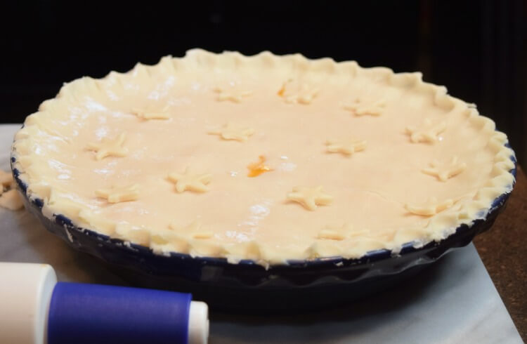My finished apricot pie ready for baking and topped with stars.