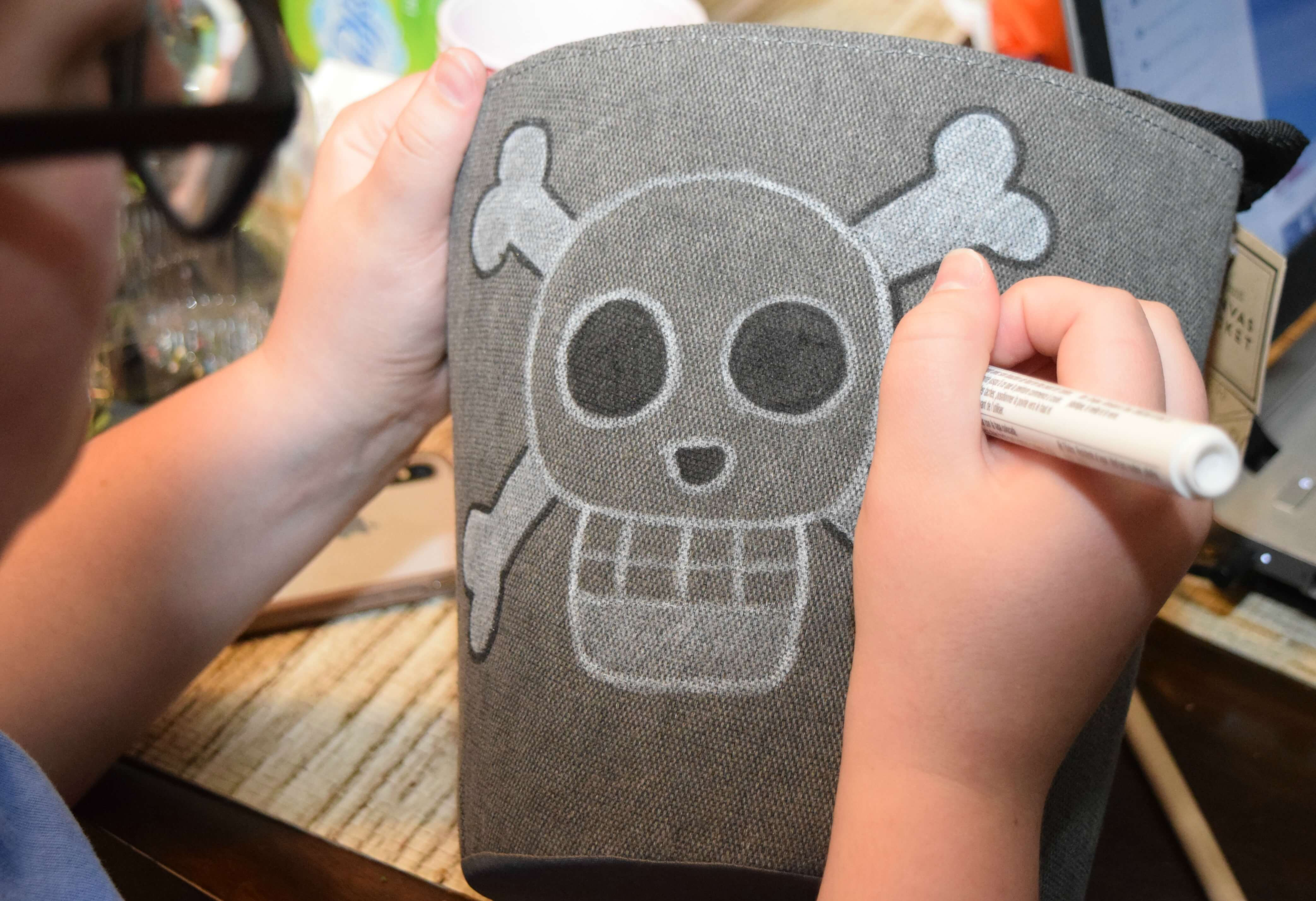 Decorate your treasure box with a jolly roger.
