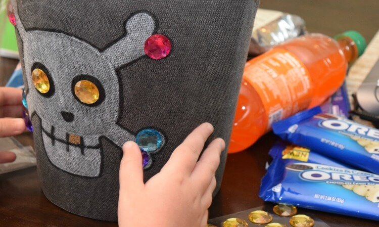 Have the kids add some rhinestone sticker jewels to the treasure box.