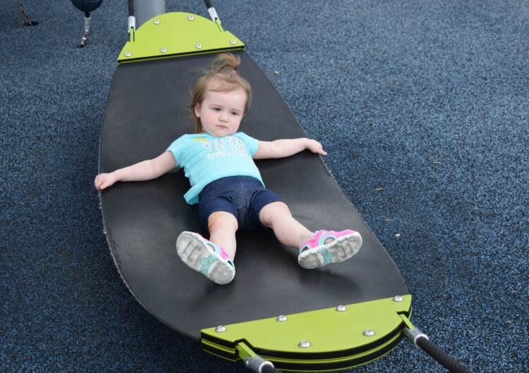 Swinging on the hammock at the playground.