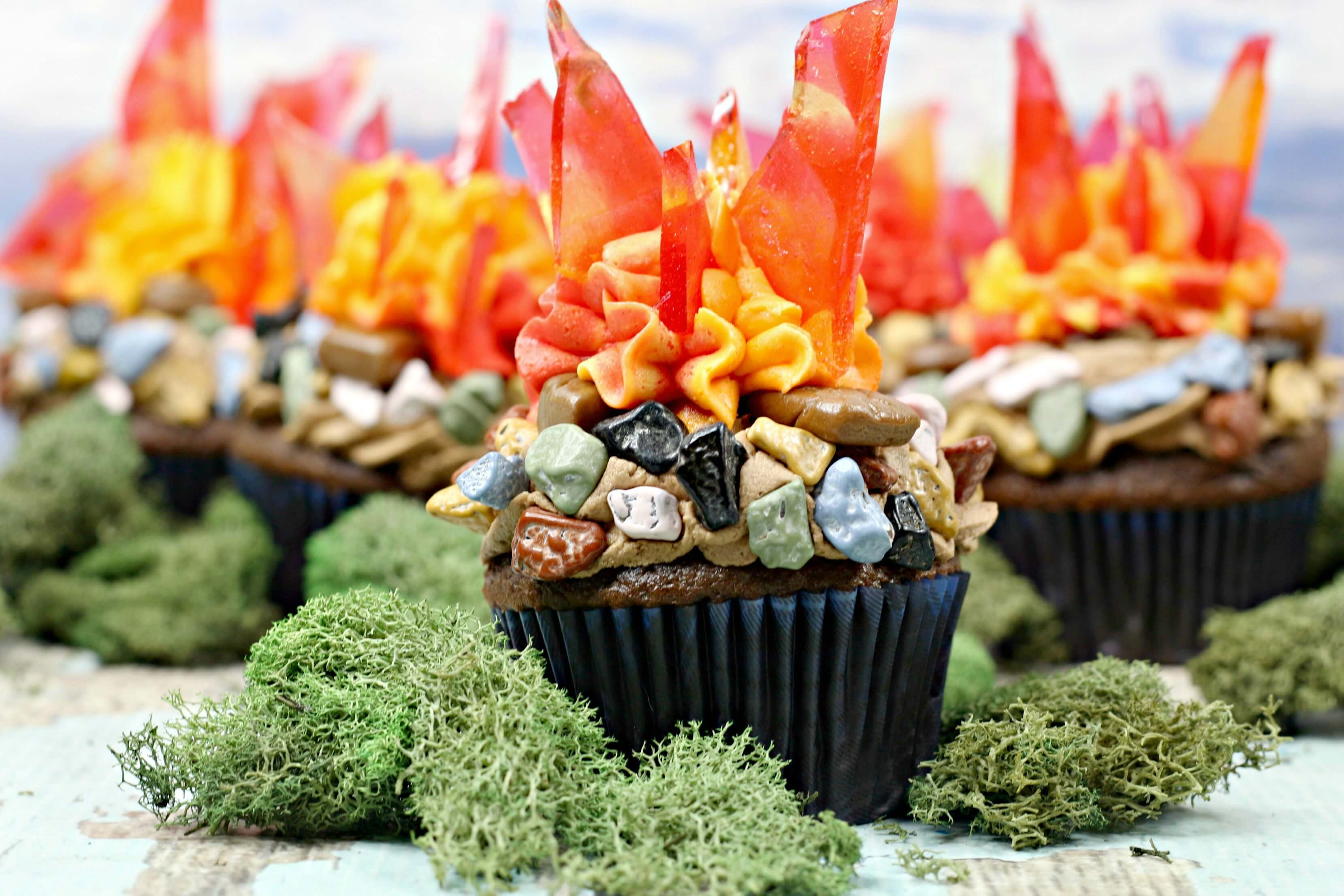 Multiple Campfire Cupcakes surrounded by moss.