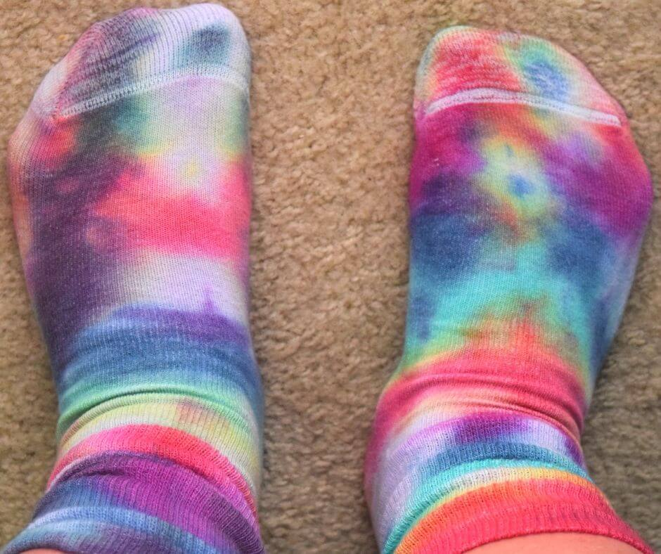 Wearing a finished pair of tie dye socks.